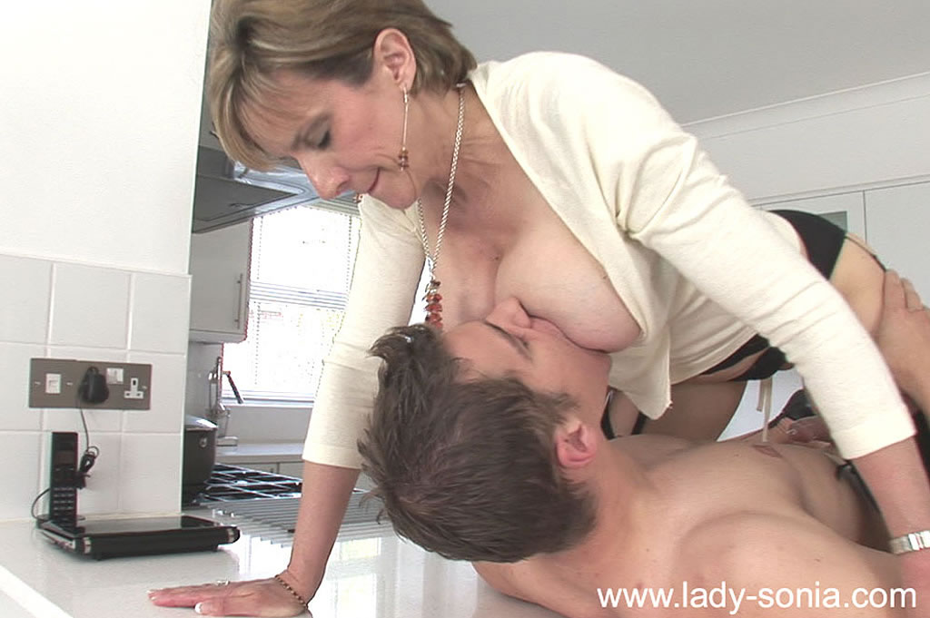 milf seduces boy