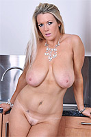 Lindsey strips to reveal her massive tits and hot round butt from Busty Britain