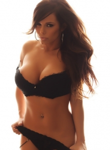 Alluring Vixen Candace glows in her black lace bra from Alluring Vixens