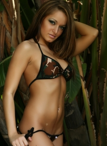Alluring Vixen Donna strips out of her camo string bikini from Alluring Vixens