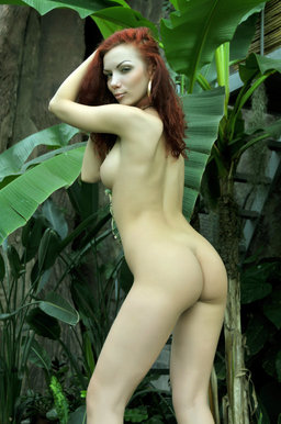 A redhead nymph slowly strips off her dainty dress from Erotic Beauty