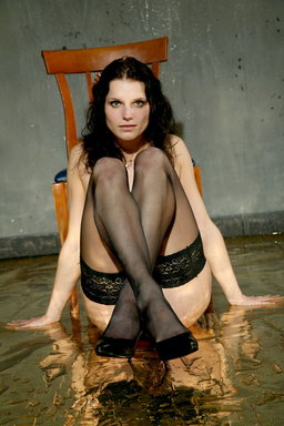 No one does the wetlook better than Alina, with her intense gaze from Erotic Beauty