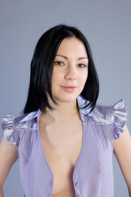Either in casual wear, or in soft lavender blouse from Erotic Beauty