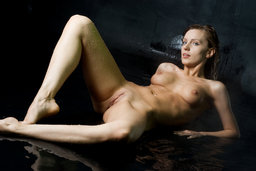 Drenched and wet but still smolderingly sexy, Gisele raises from The Life Erotic
